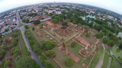 Aerial of tourists travelling ancient temple Wat Mahathat in Ayudhaya, Thailand. Stock Footage