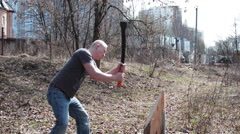 A Man With an ax Chopping Wood Stock Footage