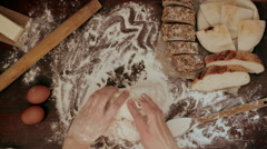 Hands kneading raw dough on the table Stock Footage