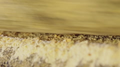 Macro shot of millstone grinding wheat - stock footage