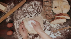 Woman pouring dough with flour Stock Footage