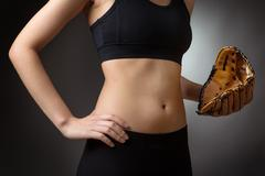 Abdomen with baseball glove - stock photo