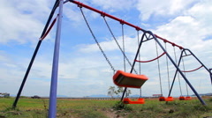 Empty Swings on Outdoor Playground Stock Footage