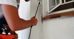Man doing pest control Stock Footage