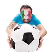 Smiling soccer fan from tha national team of italy, Football in the front - stock photo