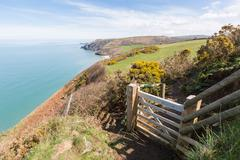 Wooden gate leading onto the Cardigan Bay Coastal Path. Penbryn Beach can be Stock Photos