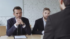 Job interview - two recruiters asking questions Stock Footage