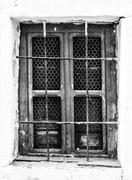 Retro photo of window with old lattice in vintage wall. Stock Photos