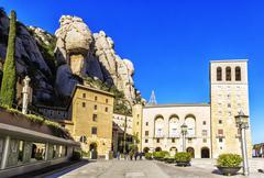 Santa Maria de Montserrat Abbey in Monistrol de Montserrat, Catalonia, Spain. - stock photo