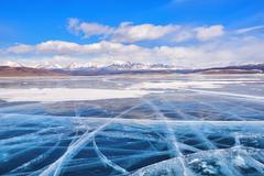 Transparent ice large mountain lake - stock photo