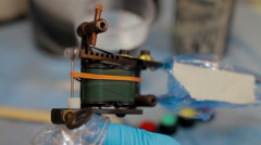 Tattoo machine preparing for making tattoo Stock Footage