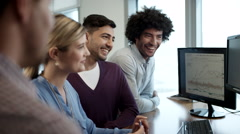 Business people using laptop and discussing at office. Stock Footage
