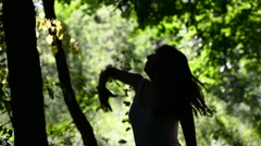 Silhouette of a dancing  young woman .Happy woman enjoying nature . - stock footage