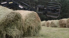 Tractor adds haycock Stock Footage