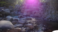 Revealing small rapids with many rocks in a valley Stock Footage