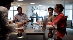 Business people discussing in conference room. Stock Footage