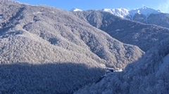 Ascending by cable car to the ski slopes. Ski resort Krasnaya Polyana, Sochi. Stock Footage