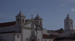 4k Church Santa Maria and church Santo Antonio towers Lagos Portugal Stock Footage
