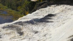 Revealing a large amount of water rushing over a big waterfall in Quebec Stock Footage