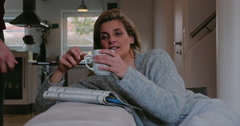Serious thoughtful woman relaxing with coffee - stock footage