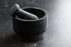 Black stone mortar. Stock Photos