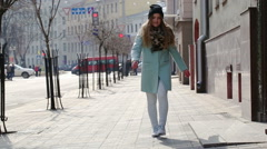 Street fashion. Happy cute girl having fun on a city street. - stock footage