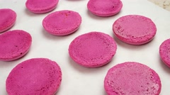 Pink Macaroon shells on baking sheet Stock Footage