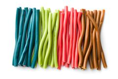 Sweet gummy sticks with different flavor. Stock Photos