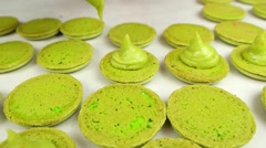 Slow motion shot of preparing pistachio Macaroons Stock Footage