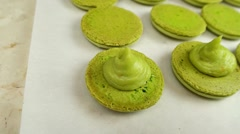 Pistachio Macaroons halves with cream Stock Footage
