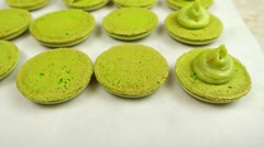 French green Macarons halves with cream Stock Footage