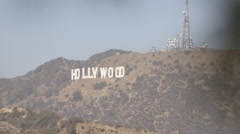 Hollywood sign focus pull from pine needle tree Stock Footage