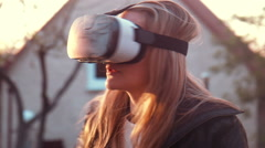 Young woman uses VR helmet Stock Footage