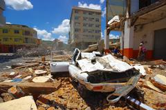 Portoviejo, Ecuador - April, 18, 2016: Collapsed car, showing the aftereffect of - stock photo