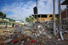 Portoviejo, Ecuador - April, 18, 2016: Mountain of rubble fro a collapsed Stock Photos