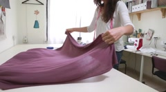 Seamstress measuring fabric Stock Footage