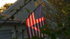 American Flag and Maryland Flag at Sunset on House in Slow Motion Stock Footage