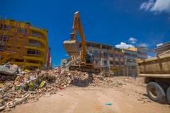 Portoviejo, Ecuador - April, 18, 2016: Heavy machinery picking rubble from - stock photo