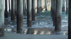 Waves hitting the pilings under the Santa Monica Pier. Stock Footage
