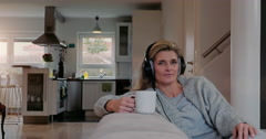 happy woman relaxing and listening to music - stock footage