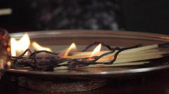 Matches burning on a plate. - stock footage