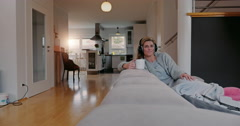 Contented woman listening to music at home - stock footage