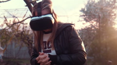 Young woman uses VR helmet with pleasure Stock Footage