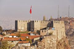 The old fortress of Ankara, also known as Ankara Kalesi, with the flag of Turkis Stock Photos