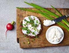 Healthy sandwich with organic multi grain bread, cream cheese and radish - stock photo