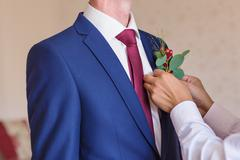 Best Man Adjusting Groom's Boutonniere close-up Stock Photos