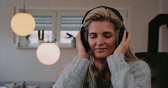 Attractive woman enjoying her music Stock Footage