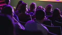 Crowd in a theatre watching a show - stock footage