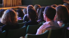 Theatre spectators shot from their backs - stock footage