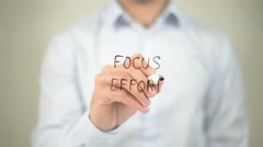 Focus Effort , writing on transparent screen - stock footage